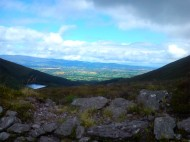 The view down to Bay Lough and across the golden vale.